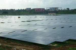 """Solar cells near cargo terminal"" by Binu jayakrishnan - Own work. Licensed under CC BY-SA 3.0 via Commons."